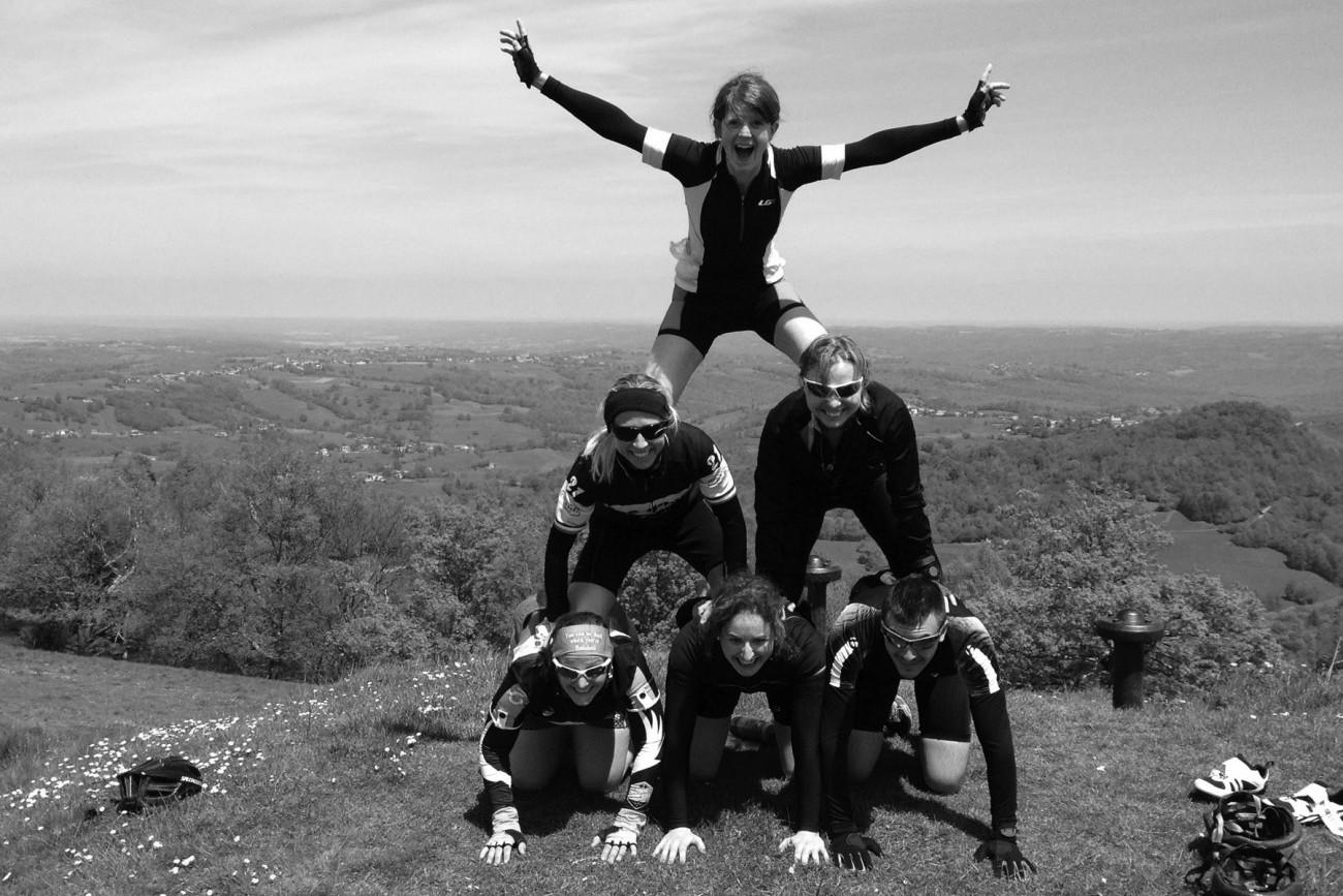 Human pyramid at the top of Pyrenees Col